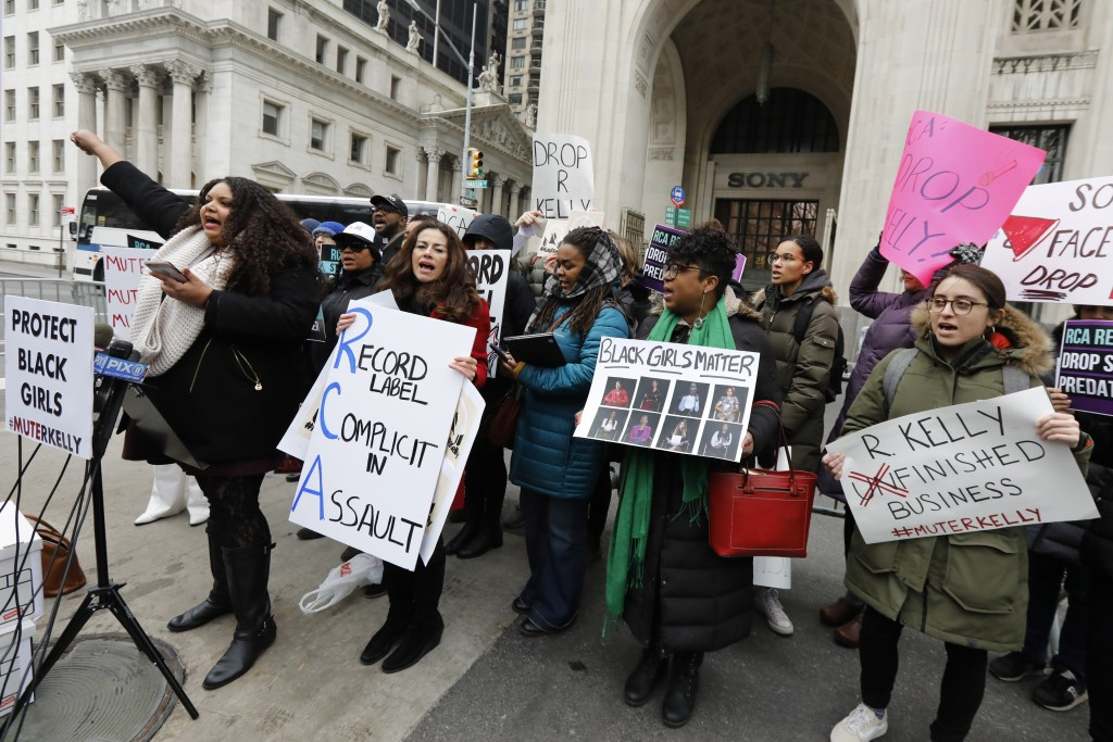 FILE - In this Jan. 16, 2019 file photo, Sonja Spoo, left, associate campaign director of Ultra Violet, leads chants during an R. Kelly protest outsid