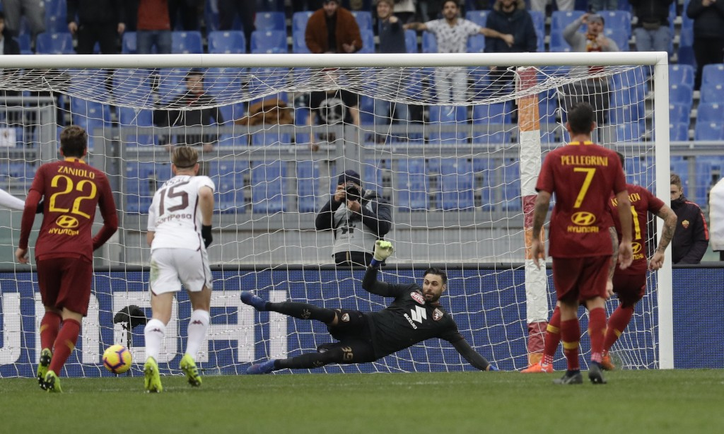 Roma's Aleksander Kolarov, right, scores his side's second goal on a penalty past Torino goalkeeper Salvatore Sirigu, during a Serie A soccer match be