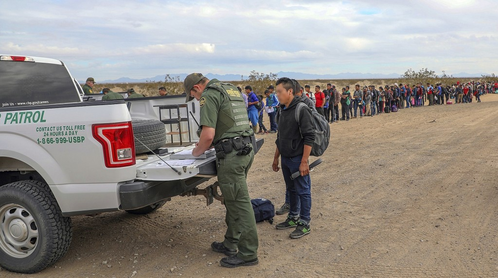 This Monday, Jan. 14, 2019 photo released by U.S. Customs and Border Protection shows some of 376 Central Americans the Border Patrol says it arrested