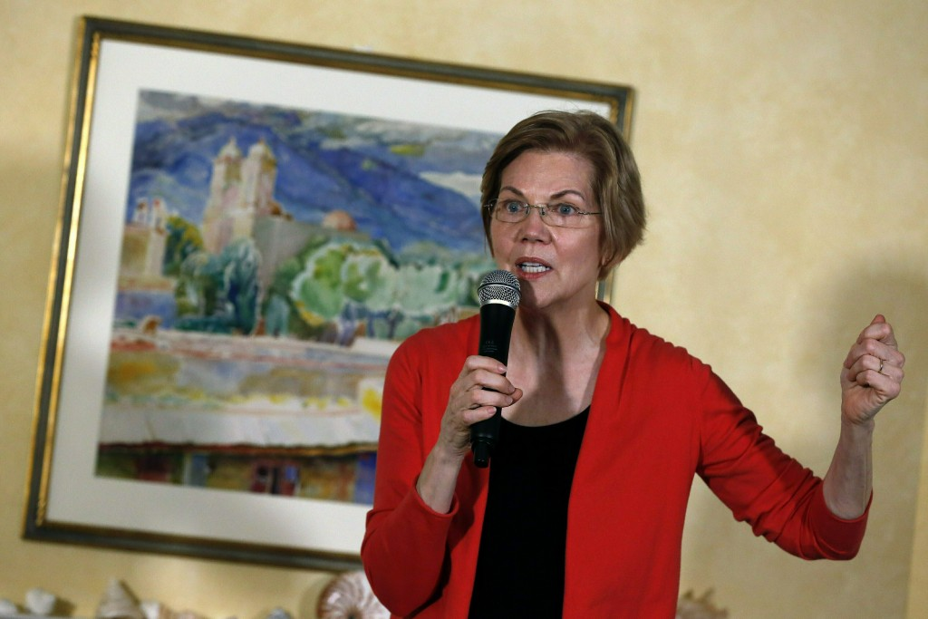 In this Jan. 12, 2019, photo, Sen. Elizabeth Warren, D-Mass., speaks during a house party in Concord, N.H. Advocates for gender equality are gearing u...