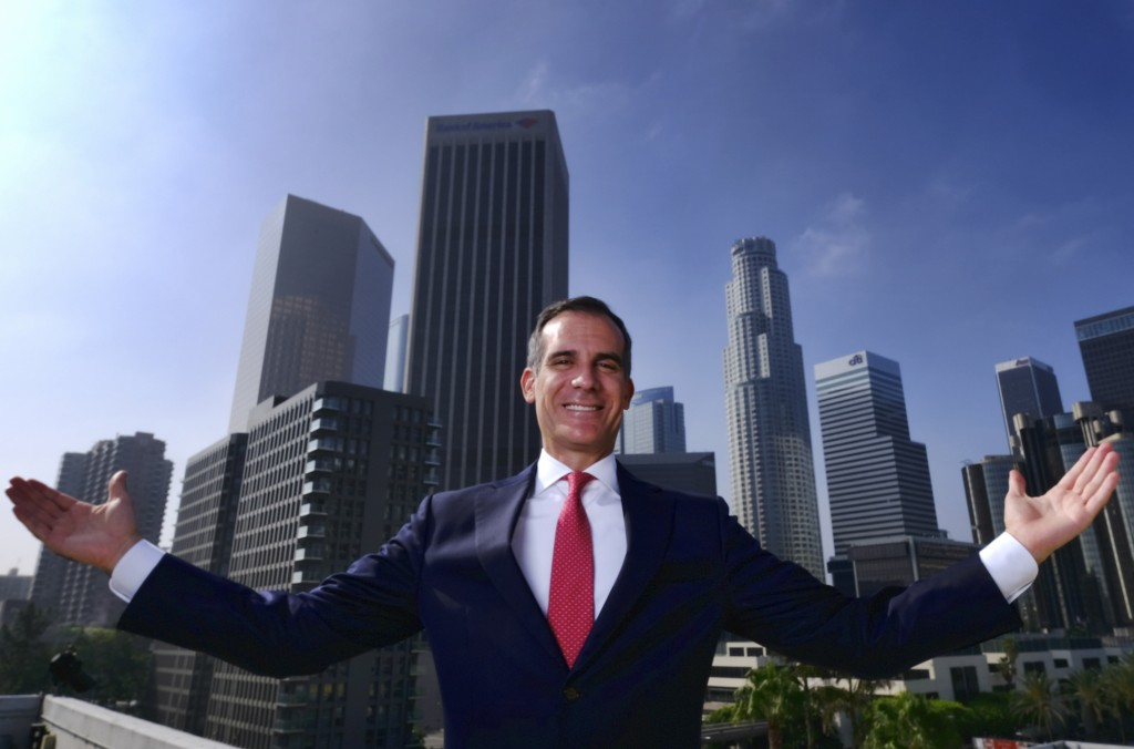 FILE - In this Aug. 23, 2018, file photo, Los Angeles Mayor Eric Garcetti poses for a photo in front of a sprawling downtown Los Angeles landscape. Th