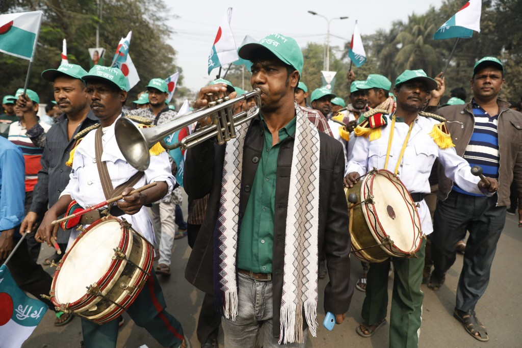 A music band performs during a rally celebrating the Awami League political party's overwhelming victory in last month's election in Dhaka, Bangladesh