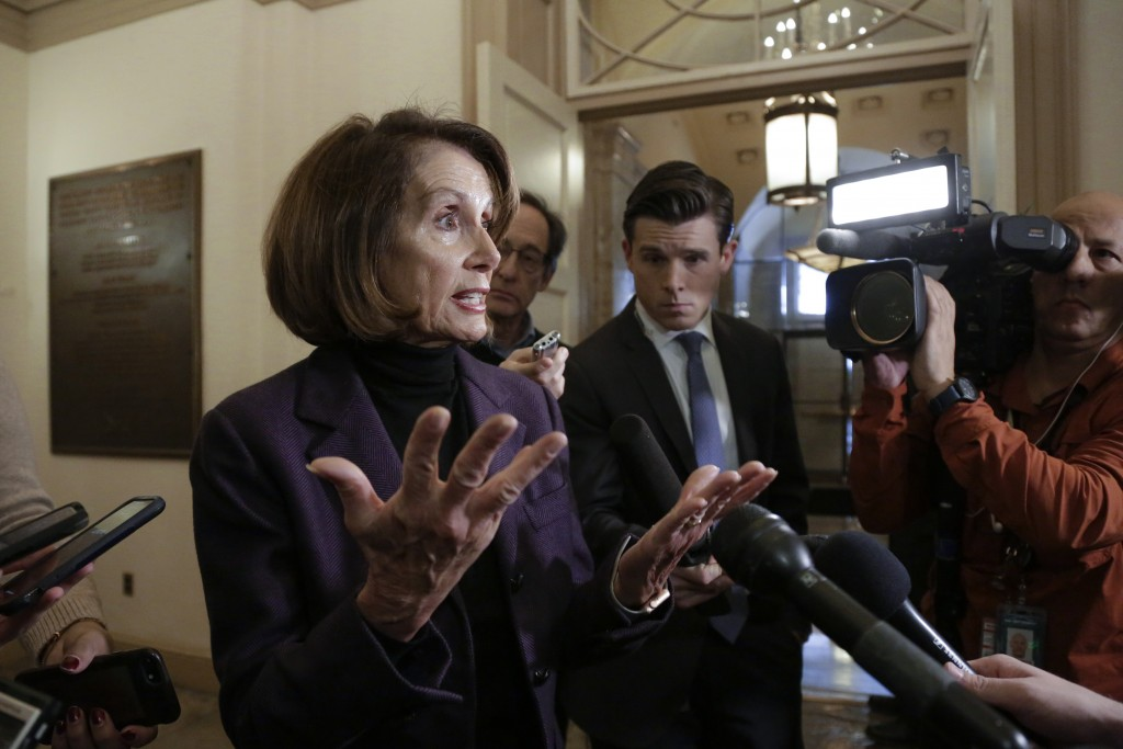 Speaker of the House Nancy Pelosi, D-Calif., takes questions from reporters, Friday, Jan. 18, 2019, on Capitol Hill in Washington.  (AP Photo/J. Scott...