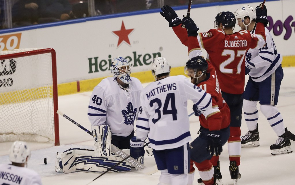 Toronto Maple Leafs goaltender Garret Sparks reacts after the Florida Panthers scored as Florida Panthers center Nick Bjugstad cheers during the first...