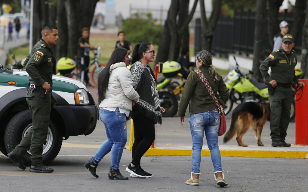 Relatives of victims of a bombing arrive at the General Francisco de Paula Santander Police Academy, a day after a car bomb exploded at the site, in B...