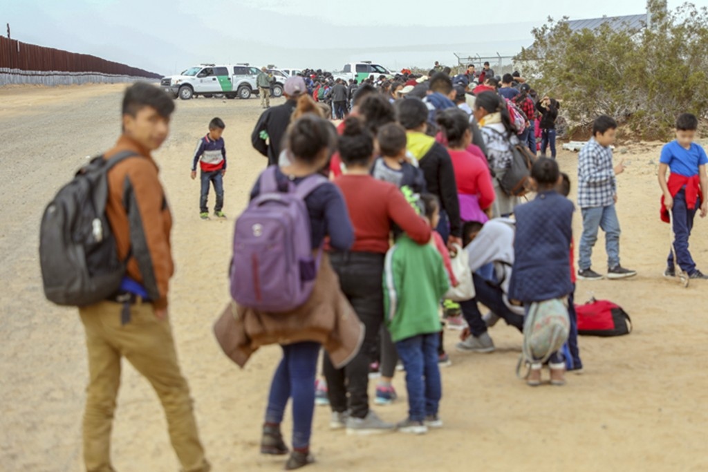 This Monday, Jan. 14, 2019 photo released by U.S. Customs and Border Protection shows some of 376 Central Americans the Border Patrol says it arrested...