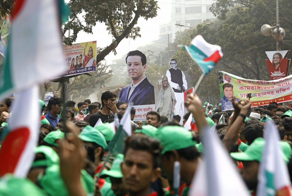 Supporters hold cut-outs of the Awami League political party leaders during a rally celebrating the party's overwhelming victory in last month's elect...