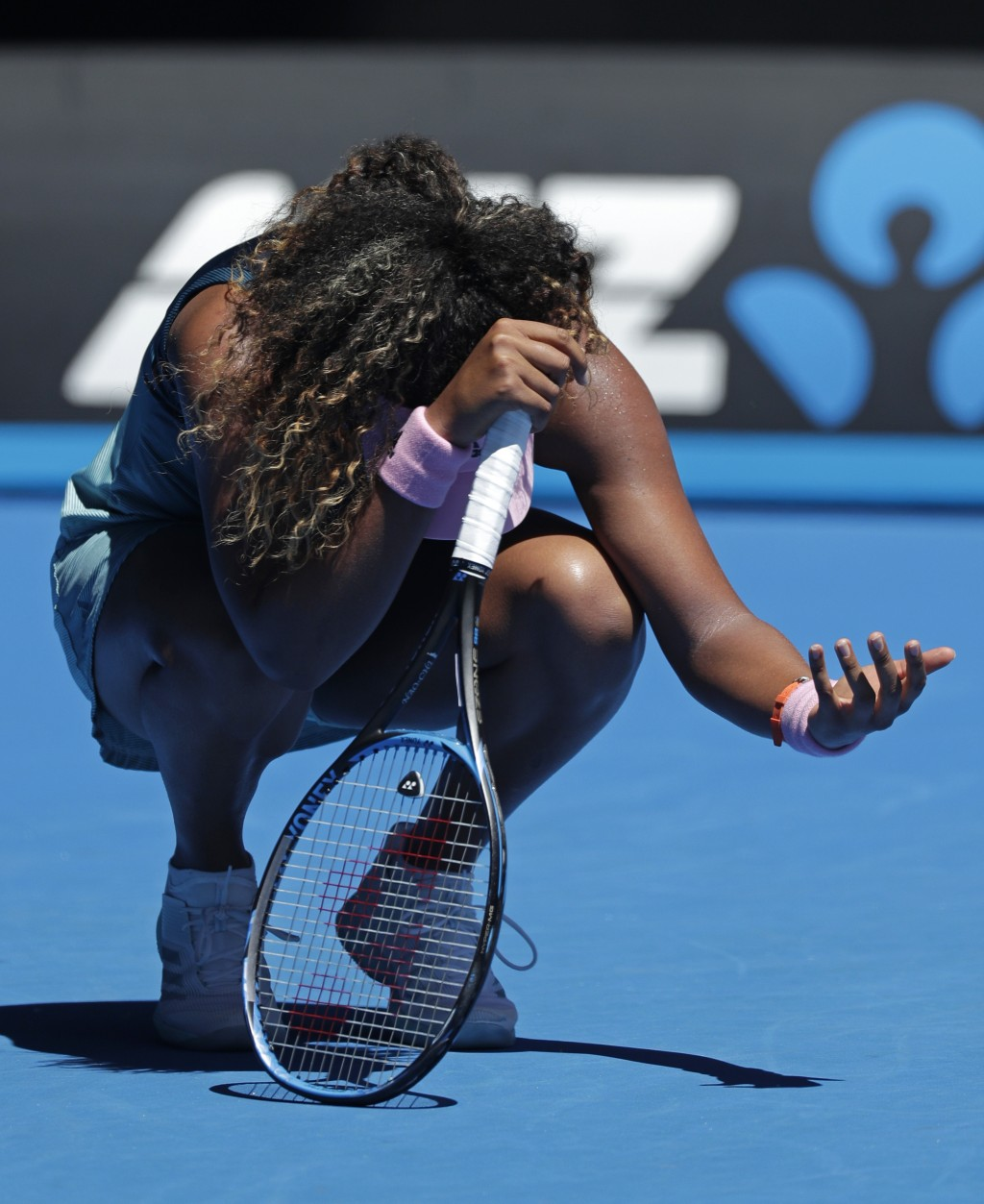 Japan's Naomi Osaka reacts after losing a point against Taiwan's Hsieh Su-Wei during in third round match at the Australian Open tennis championships
