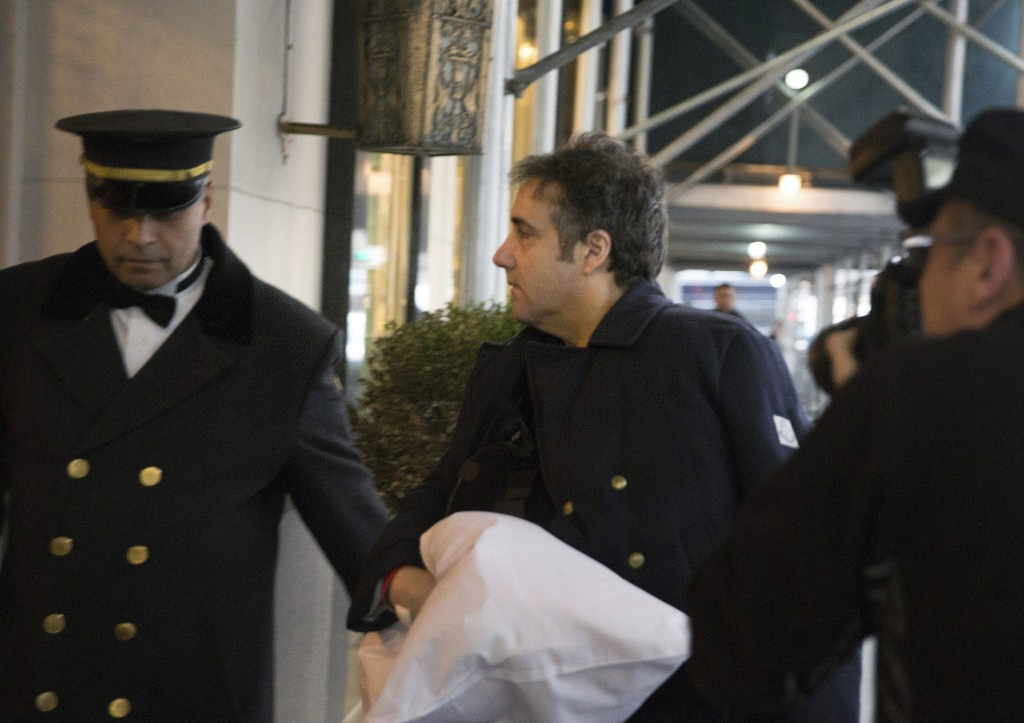 ADDS THAT COHEN'S LEFT ARM IS IN A SLING - Michael Cohen arrives at his home in New York with his left arm in a sling supported by a pillow Friday, Ja...