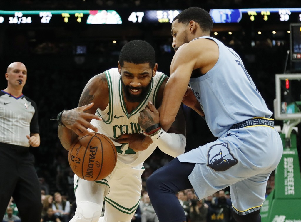 Kyrie Irving loses the ball while trying to get past Memphis Grizzlies' Garrett Temple during the second quarter of an NBA basketball game Friday, Jan