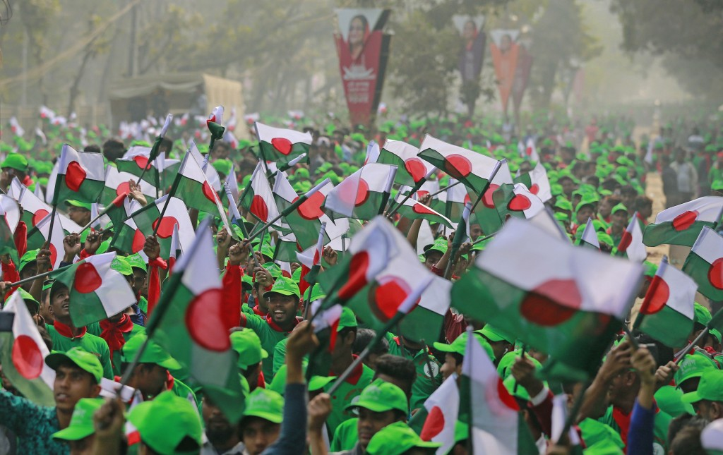 Supporters wave Awami League political party flags during a rally celebrating the party's overwhelming victory in last month's election in Dhaka, Bang...