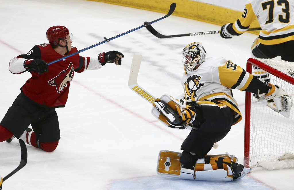 Arizona Coyotes defenseman Jakob Chychrun (6) collides with Pittsburgh Penguins goaltender Matt Murray (30) sending both to the ice during the first p...