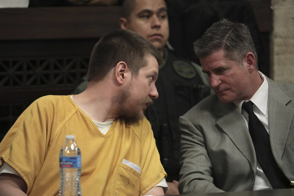 Former Chicago police Officer Jason Van Dyke confers with his attorney Daniel Herbert during his sentencing hearing for the 2014 shooting of Laquan Mc...