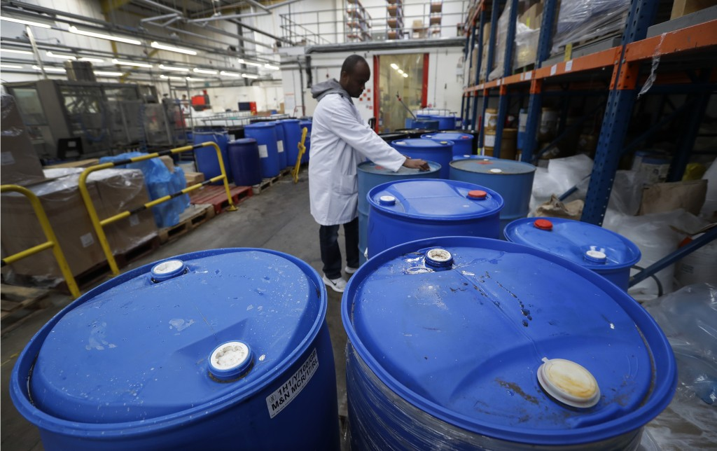 In this photo taken on Thursday, Jan. 17, 2019, Mo Hussein stands with vats containing ingredients at the Clarity-The Soap Co. premises in London. Ami