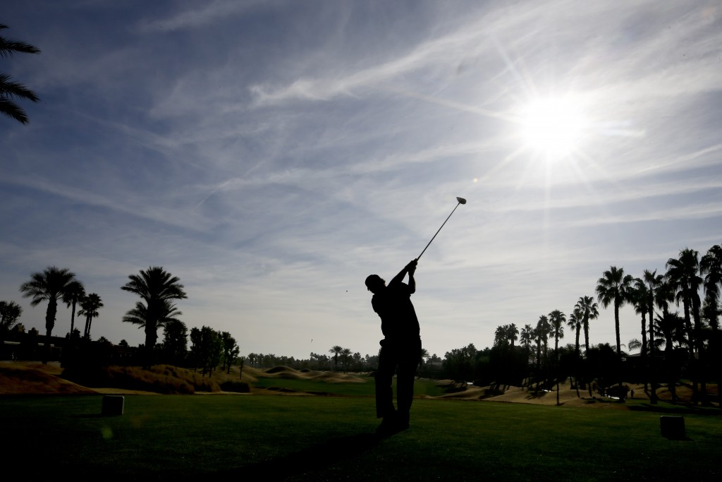 Phil Mickelson watches his tee shot on the 11th hole during the second round of the Desert Classic golf tournament on the Nicklaus Tournament Course a