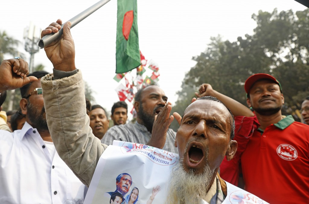 Supporters of Awami League political party shout slogans as they rally to celebrate the party's overwhelming victory in last month's election in Dhaka