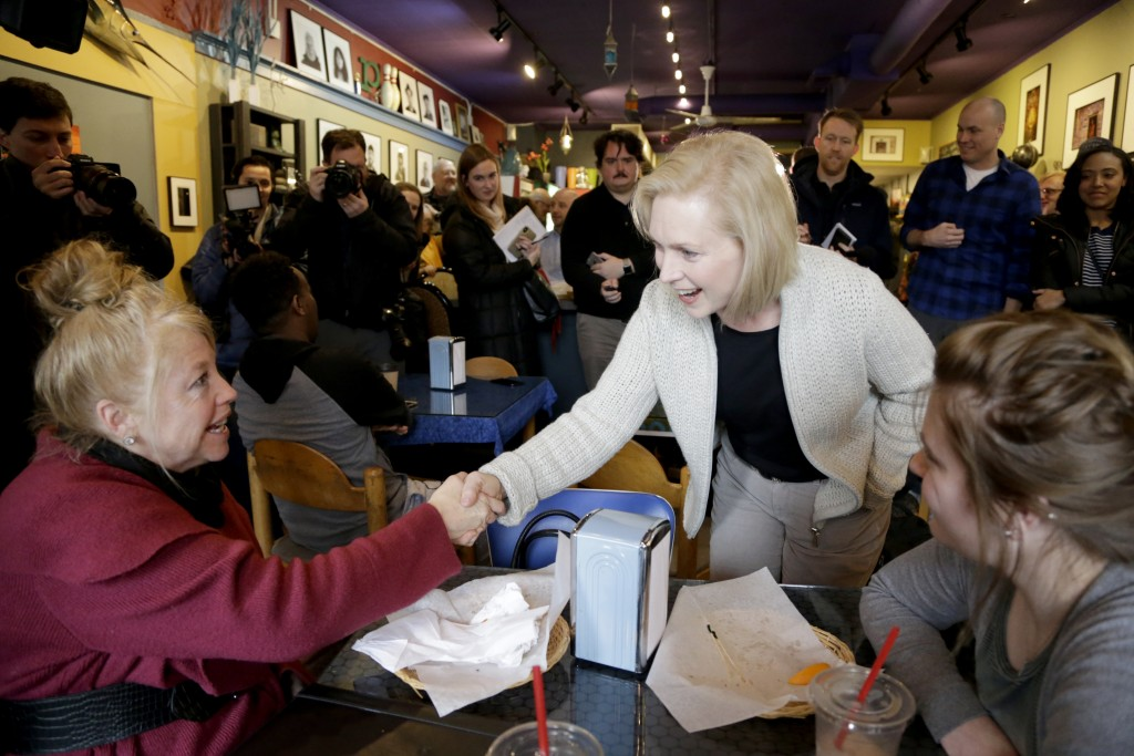 Senator Kirsten Gillibrand, D-N.Y., center, campaigns at the Pierce Street Coffee Works cafe', in Sioux City, Iowa, Friday, Jan. 18, 2019. Sen. Gillib