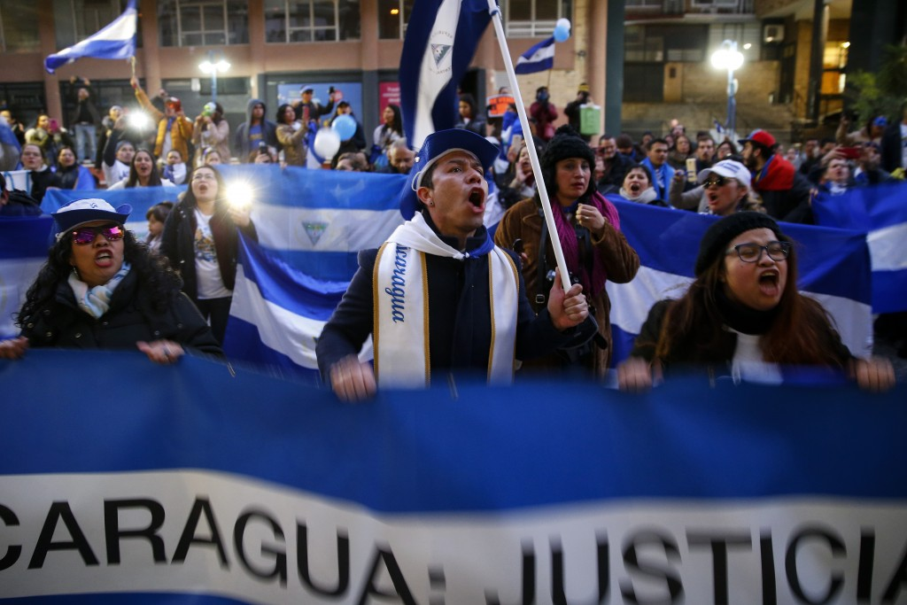 FILE - In this Jan. 12, 2019 file photo, demonstrators chant during a protest against the Nicaraguan government, in Madrid, Spain. A group of independ...