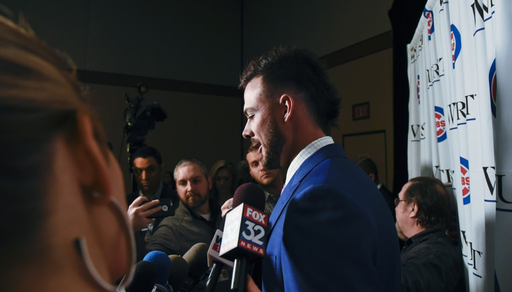 Chicago Cubs' Kris Bryant talks with reporters during the baseball team's annual convention Friday, Jan. 18, 2019, in Chicago. (AP Photo/Matt Marton)