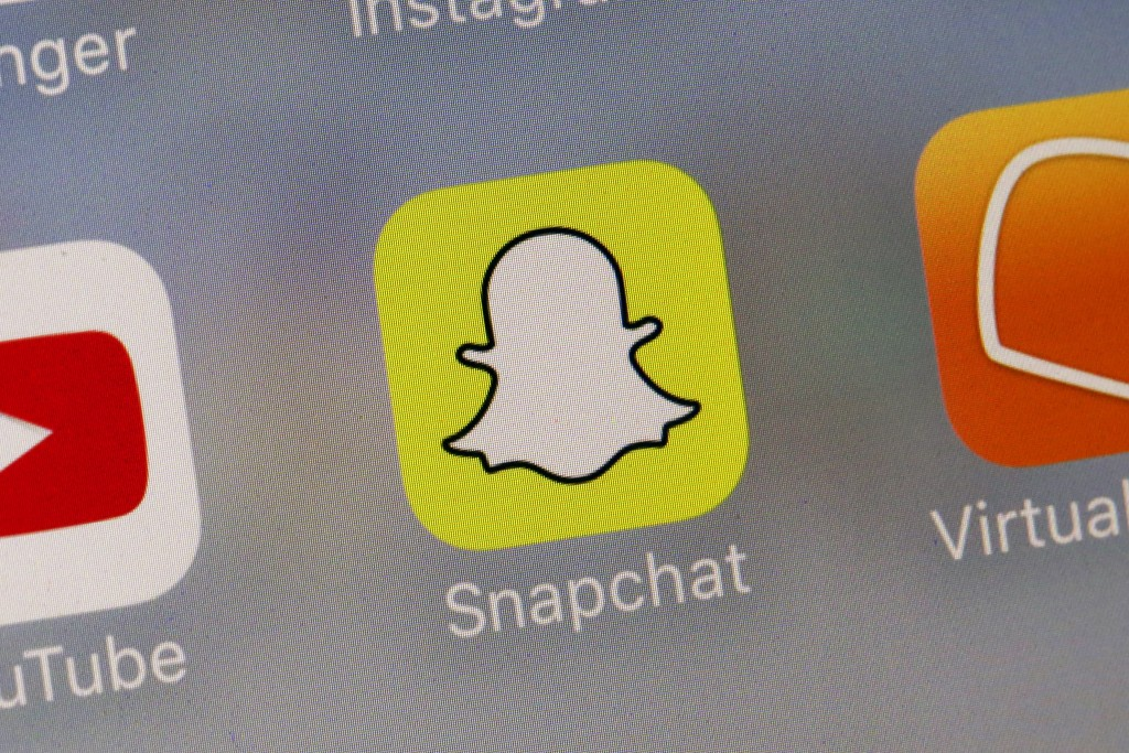 FILE - This Wednesday, Aug. 9, 2017, file photo shows the Snapchat app. The Wall Street Journal reports Friday, Jan. 18, 2019, that Snap recently fire...