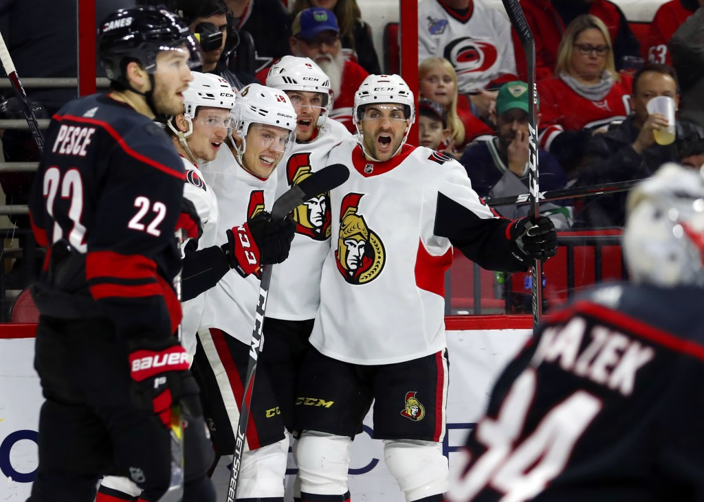 The Ottawa Senators celebrate a goal against the Carolina Hurricanes during the second period of an NHL hockey game in Raleigh, N.C., Friday, Jan. 18,