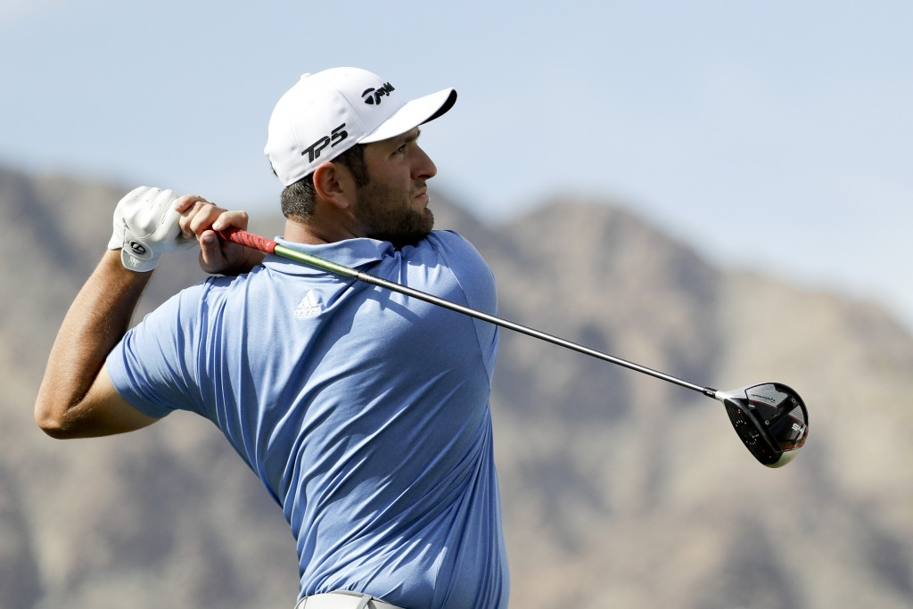 Jon Rahm, of Spain, watches his tee shot on the first hole during the second round of the Desert Classic golf tournament on the Nicklaus Tournament Co