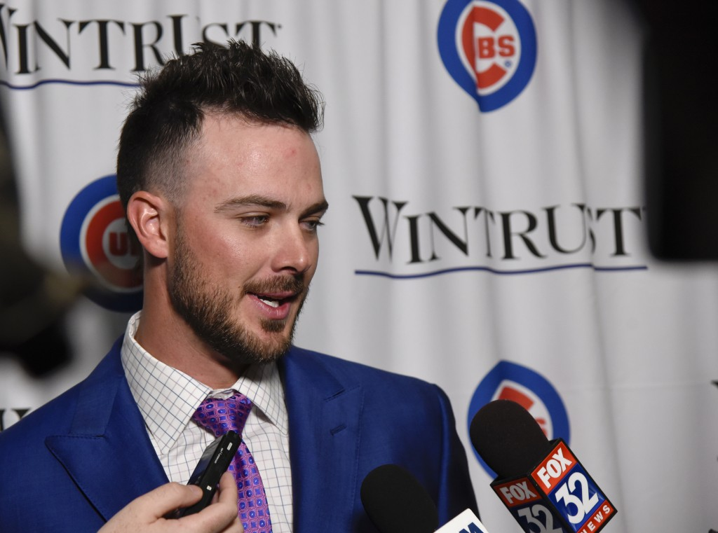 Chicago Cubs' Kris Bryant talks with the media during the baseball team's annual convention Friday, Jan. 18, 2019, in Chicago. (AP Photo/Matt Marton)