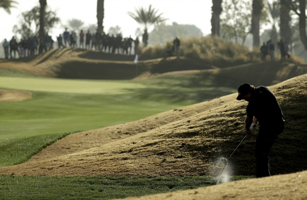 Phil Mickelson hits from rough on the 10th hole during the second round of the Desert Classic golf tournament on the Nicklaus Tournament Course at PGA