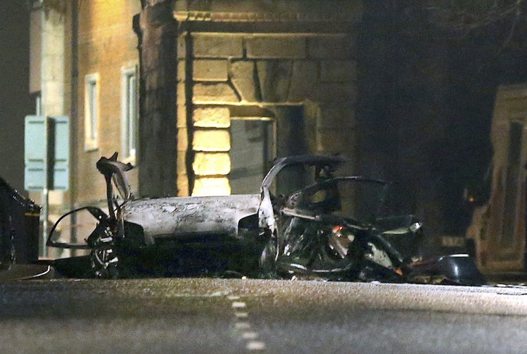 This photo taken on Saturday, Jan. 19, 2019 shows the scene of a suspected car bomb on Bishop Street in Londonderry, Northern Ireland. Northern Irelan