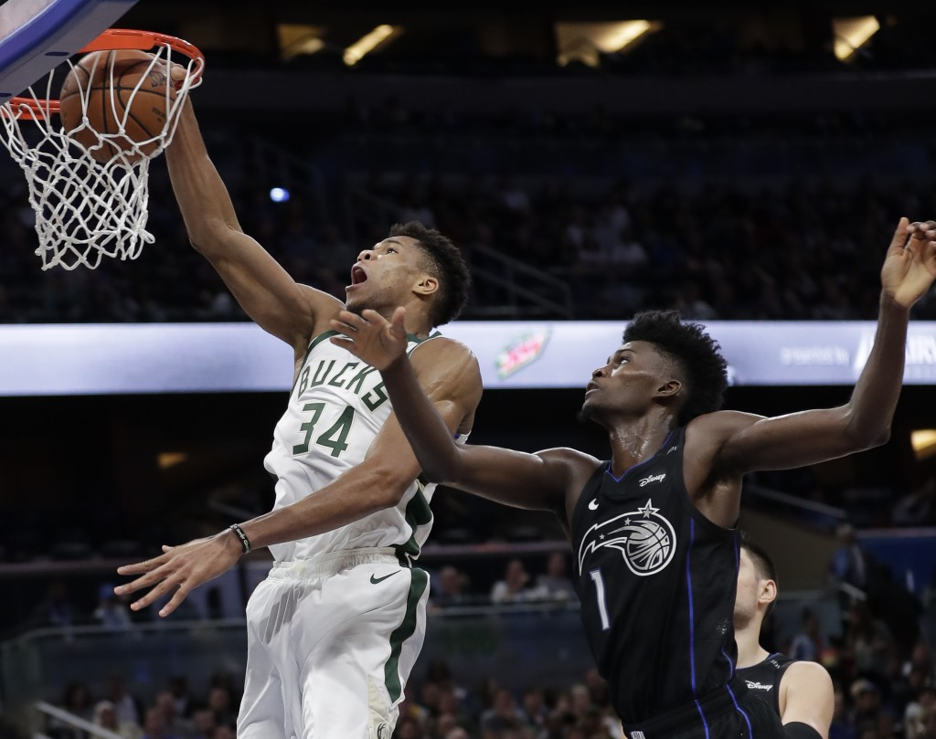Milwaukee Bucks' Giannis Antetokounmpo (34) goes to the basket in front of Orlando Magic's Jonathan Isaac (1) during the second half of an NBA basketb...