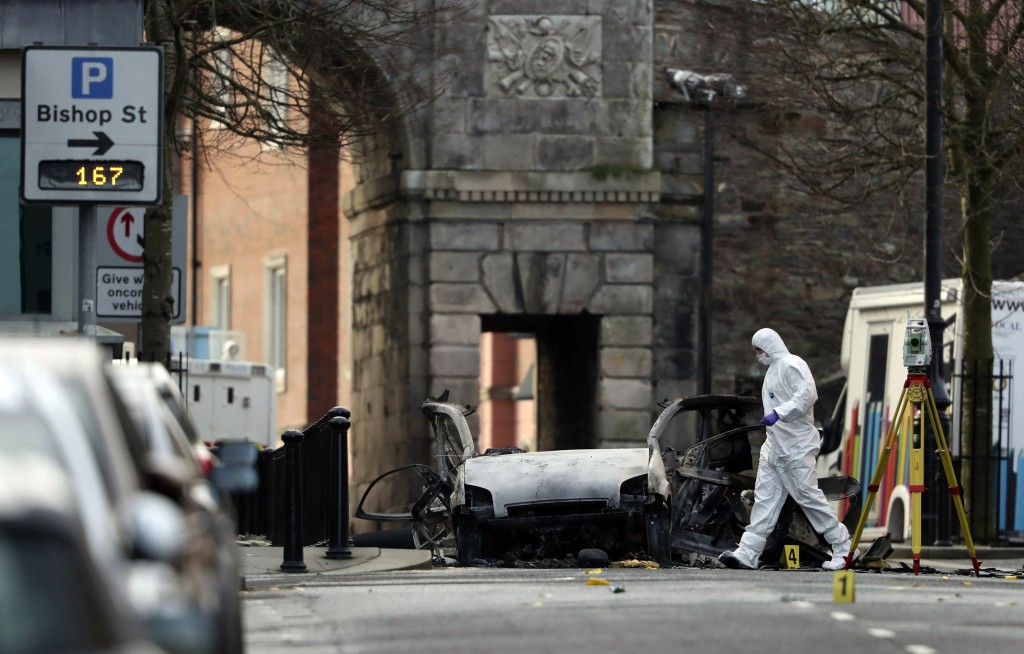 Forensic investigators at the scene of a car bomb blast on Bishop Street in Londonderry, Northern Ireland, Sunday, Jan. 20, 2019. Northern Ireland pol