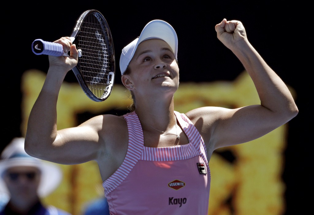Australia's Ashleigh Barty celebrates after defeating Russia's Maria Sharapova in their fourth round match at the Australian Open tennis championships