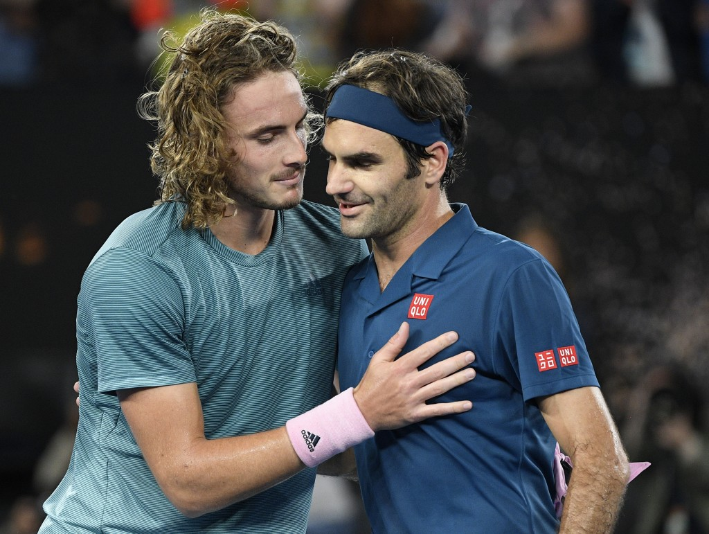 Greece's Stefanos Tsitsipas, left, is congratulated by Switzerland's Roger Federer after winning their fourth round match at the Australian Open tenni...