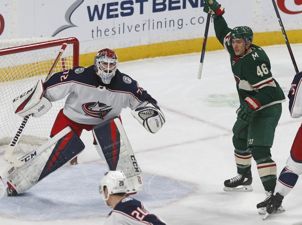 Minnesota Wild's Jared Spurgeon, right, celebrates a goal off Columbus Blue Jackets' goalie Sergei Bobrovsky, left, of Russia, by Jordan Greenway duri...