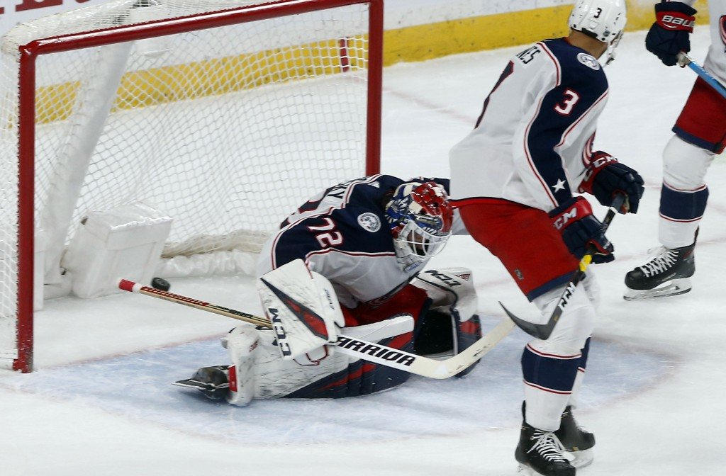 Columbus Blue Jackets' goalie Sergei Bobrovsky, of Russia, gives up a goal to Minnesota Wild's Zach Parise in the first period of an NHL hockey game S...