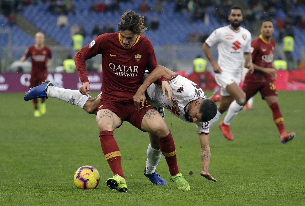 Roma's Nicolo Zaniolo, left, and Torino's Tomas Rincon vie for the ball during a Serie A soccer match between Roma and Torino, at the Rome Olympic Sta