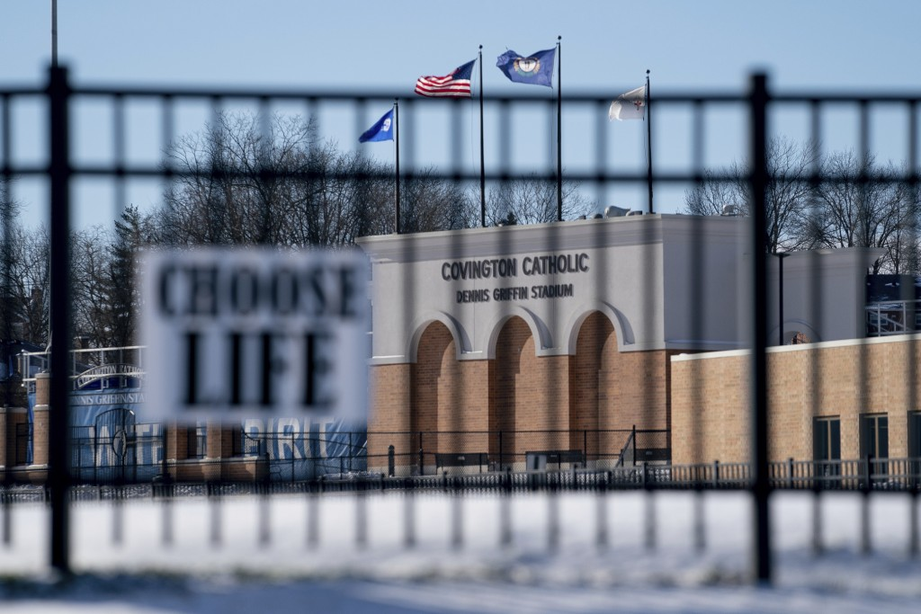 Flags fly over the Covington Catholic High School stadium in Park Kills, Ky., Sunday, Jan 20, 2019. A diocese in Kentucky has apologized after videos