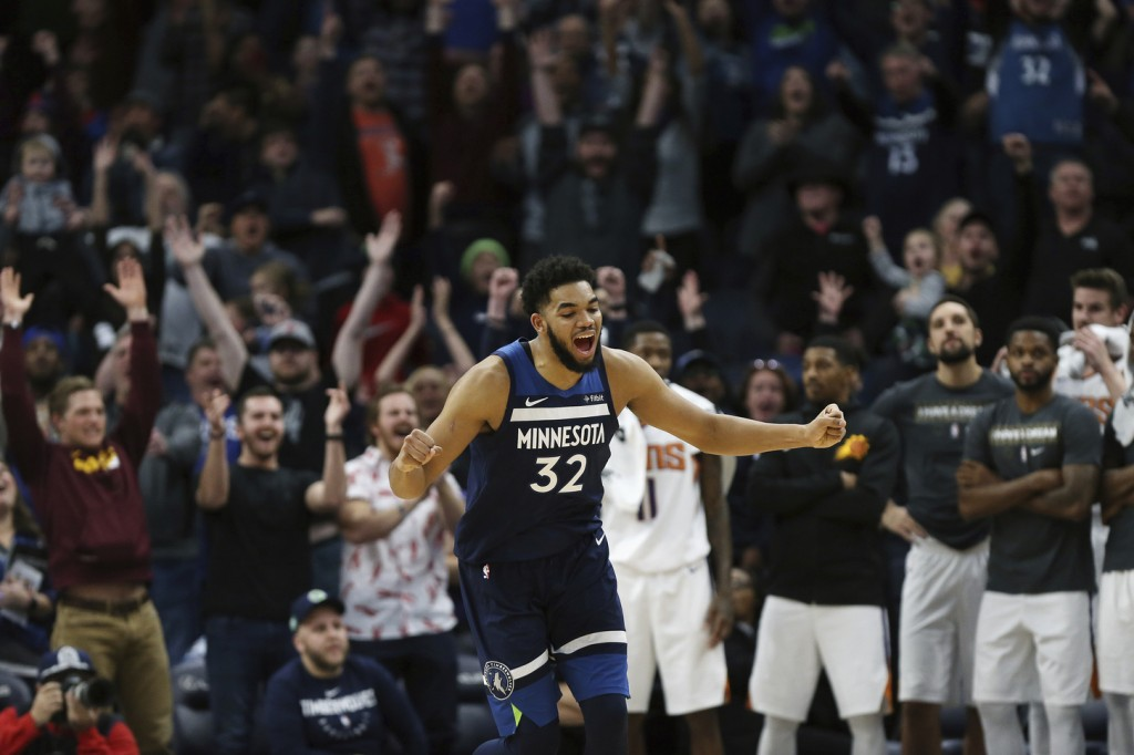 Minnesota Timberwolves' Karl-Anthony Towns reacts his team's lead over the Phoenix Suns' in the second half of an NBA basketball game Sunday, Jan. 20,...