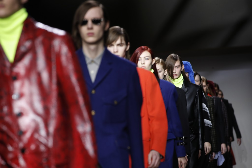 Models wear creations for the Paul Smith men's Fall/Winter 2019/20 fashion collection presented in Paris, Sunday Jan.19, 2019. (AP Photo/Christophe En