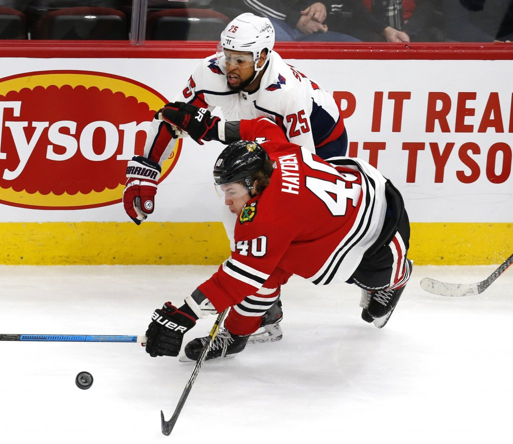 Chicago Blackhawks right wing John Hayden (40) tries to get to a puck ahead of Washington Capitals right wing Devante Smith-Pelly (25) during the thir