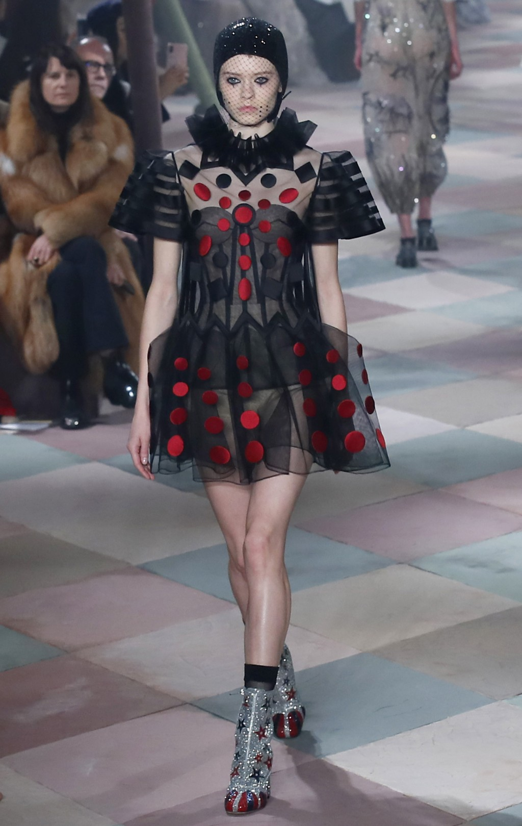 A model wears a creation for the Dior Spring/Summer 2019 Haute Couture fashion collection presented in Paris, Monday Jan. 21, 2019. (AP Photo/Francois