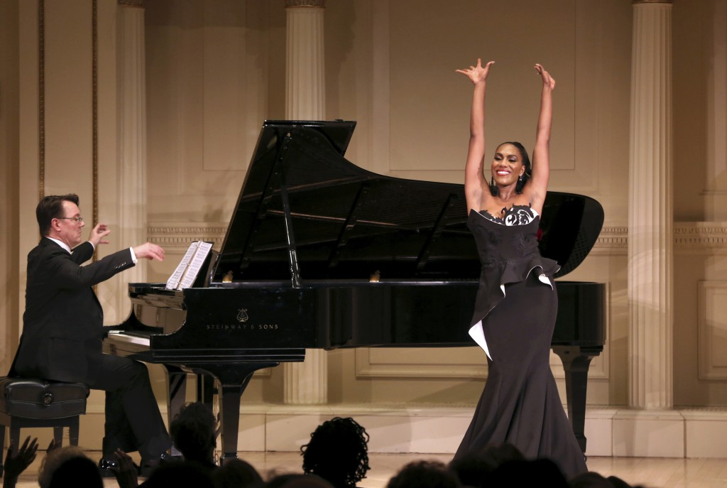 In this Dec. 13, 2018, photo provided by Carnegie Hall, J'nai Bridges, a mezzo-soprano, performs in her recital, accompanied by Mark Markham on piano,...