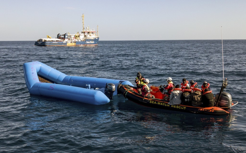 In this photo taken on Saturday, Jan. 19, 2019, a Sea-Watch ship approaches a dinghy boat to rescue migrants in the Mediterranean Sea. A private rescu...