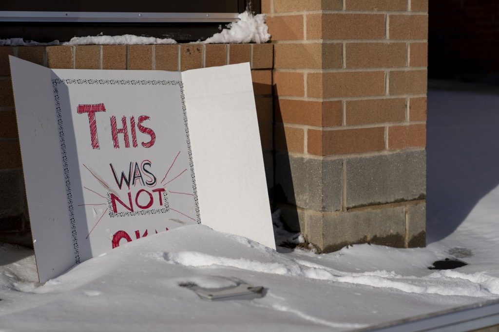 """A sign reading """"This was not okay,"""" is seen in front of Covington Catholic High School in Park Kills, Ky., Sunday, Jan 20, 2019. A diocese in Kentucky"""