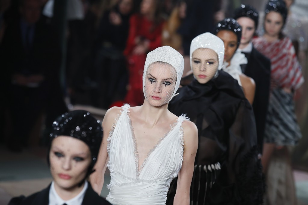 Models wear creations for the Dior Spring/Summer 2019 Haute Couture fashion collection presented in Paris, Monday Jan. 21, 2019. (AP Photo/Francois Mo