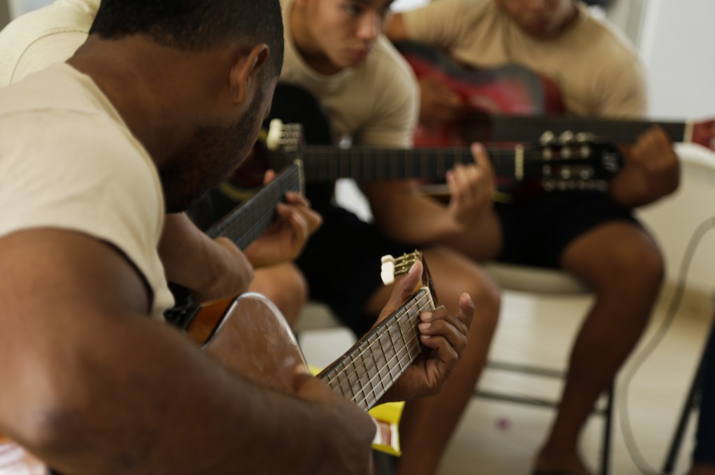 A group of young inmates play guitars during choir practice at the Las Garzas de Pacora detention center, Panama, Wednesday, Jan. 16, 2019. The group ...