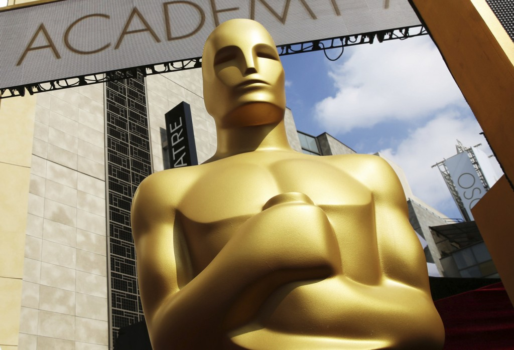 FILE - In this Feb. 21, 2015, file photo, an Oscar statue appears outside the Dolby Theatre for the 87th Academy Awards in Los Angeles. Nominations fo