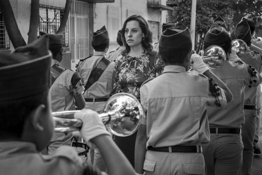 "This image released by Netflix shows Marina de Tavira, center, in a scene from the film ""Roma,"" by filmmaker Alfonso Cuaron.  On Tuesday, Jan. 22, 201"