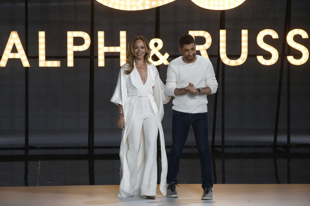 Designers Tamara Ralph, left, and Michael Russo accept applause at the end of the Ralph & Russo Spring/Summer 2019 Haute Couture fashion collection pr
