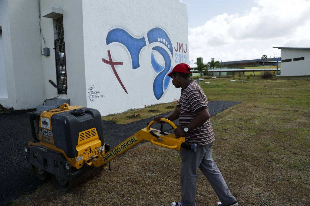 A man works outside the small chapel where Pope Francis will gather with young inmates at the Las Garzas de Pacora detention center, Panama, Wednesday...